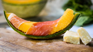 A slice of melon with prosciutto and cheese. J. starling Photography Commercial Photography