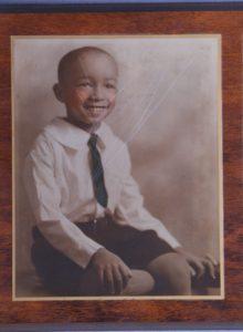 Childhood photo damaged before restoration