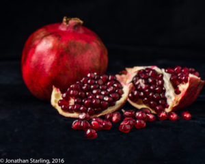Photo of a pomegranate on black background product photography in Dalton, GA and Chattanooga, TN