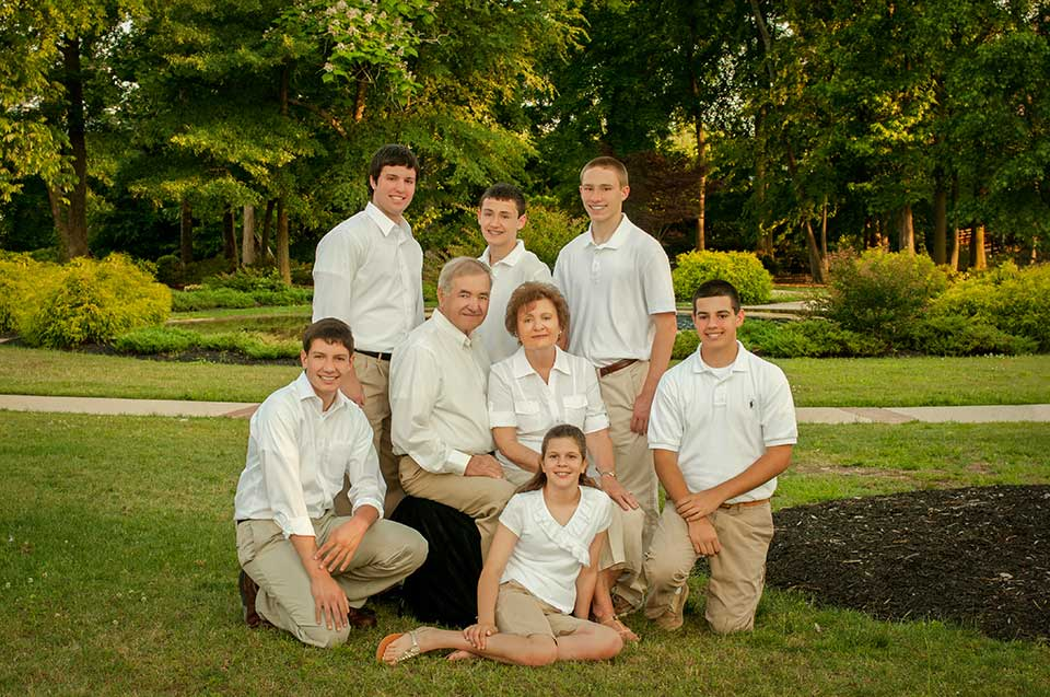 Family portrait outdoors with grandparents and grandchildren
