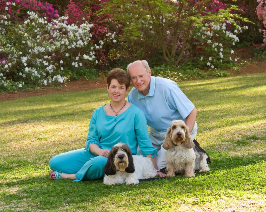 Photograph of a man and woman with their dogs in an outdoor setting by J. Starling photography Dalton, GA